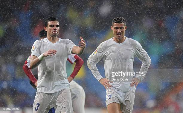 Cristiano Ronaldo of Real Madrid reacts with Pepe during the La Liga match between Real Madrid CF and Real Sporting de Gijon at Estadio Santiago...