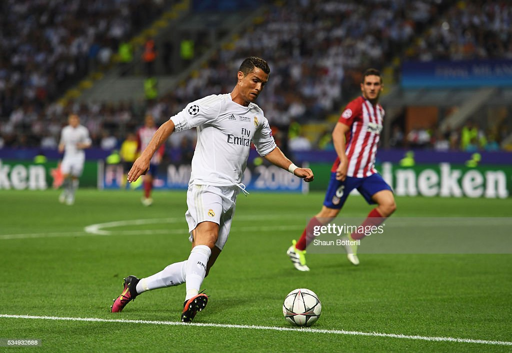 <a gi-track='captionPersonalityLinkClicked' href=/galleries/search?phrase=Cristiano+Ronaldo+-+Soccer+Player&family=editorial&specificpeople=162689 ng-click='$event.stopPropagation()'>Cristiano Ronaldo</a> of Real Madrid runs at the Atletico Madrid defence during the UEFA Champions League Final match between Real Madrid and Club Atletico de Madrid at Stadio Giuseppe Meazza on May 28, 2016 in Milan, Italy.