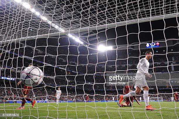 Cristiano Ronaldo of Real Madrid runs away after the ball hits the net after his teammate James Rodriguez scores Real's 2nd goal during the UEFA...