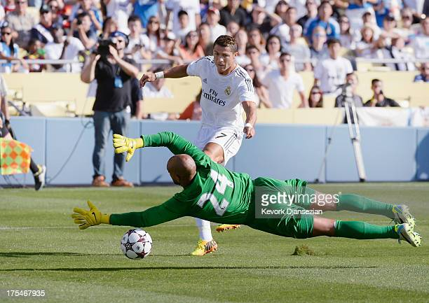 Cristiano Ronaldo of Real Madrid scores a goal against goalkeeper Tim Howard of Everton during the first half of the 2013 Guinness International...