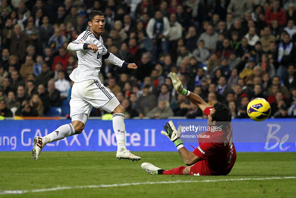Cristiano Ronaldo (L) of Real Madrid scores during the La Liga match between Real Madrid and Real Sociedad at Estadio Santiago Bernabeu on January 6, 2013 in Madrid, Spain.