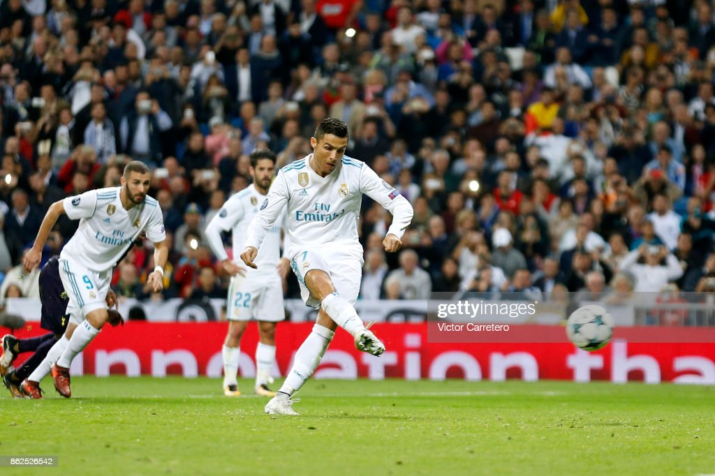 Cristiano Ronaldo of Real Madrid scores from penalty spot his team's first goal during the UEFA Champions League group H match between Real Madrid CF and Tottenham Hotspur at Estadio Santiago Bernabeu on October 17, 2017 in Madrid, Spain.
