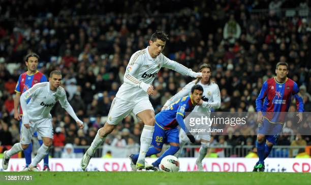 Cristiano Ronaldo of Real Madrid scores from the penalty spot during the la Liga match between Real Madrid and Levante at Estadio Santiago Bernabeu...