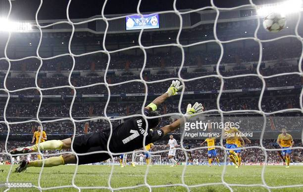 Cristiano Ronaldo of Real Madrid scores from the penalty spot his team's second goal past Gianluigi Buffon of Juventus during the UEFA Champions...
