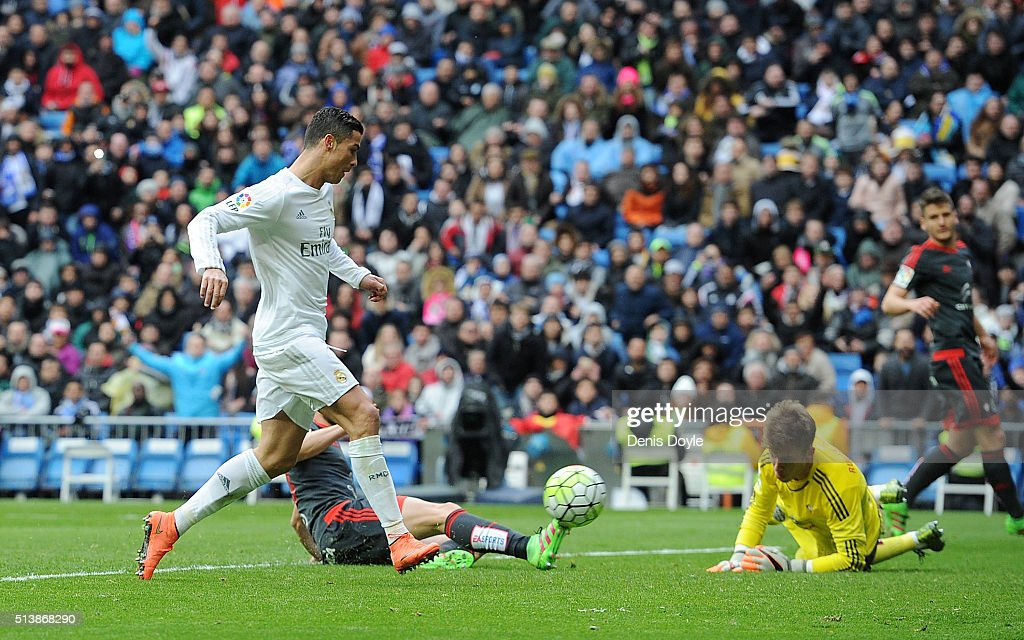 Cristiano Ronaldo of Real Madrid scores his 3rd goal against Ruben Blanco of Celta Vigo during the La Liga match between Real Madrid CF and Celta...