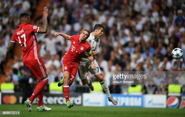 Cristiano Ronaldo of Real Madrid scores his sides first goal during the UEFA Champions League Quarter Final second leg match between Real Madrid CF...