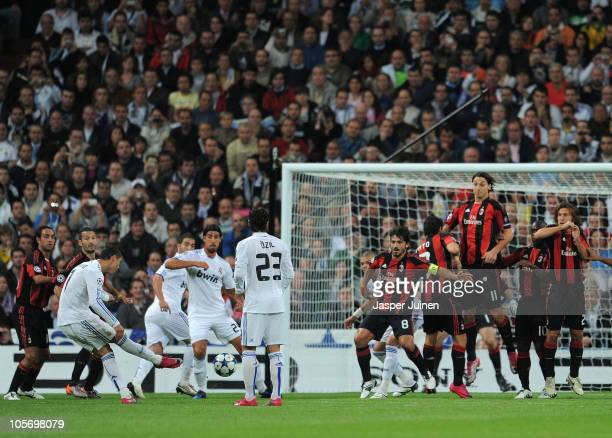Cristiano Ronaldo of Real Madrid scores his sides opening goal from a free kick during the UEFA Champions League group G match between Real Madrid...