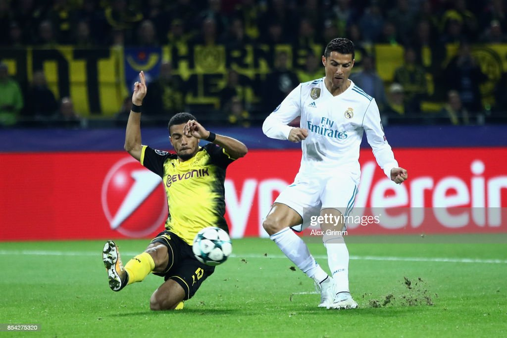 Cristiano Ronaldo of Real Madrid scores his sides second goal as Jeremy Toljan of Borussia Dortmund attempts to block during the UEFA Champions League group H match between Borussia Dortmund and Real Madrid at Signal Iduna Park on September 26, 2017 in Dortmund, Germany.