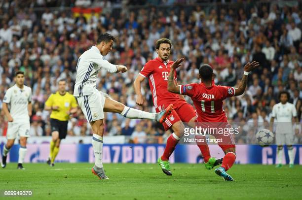 Cristiano Ronaldo of Real Madrid scores his sides second goal during the UEFA Champions League Quarter Final second leg match between Real Madrid CF...