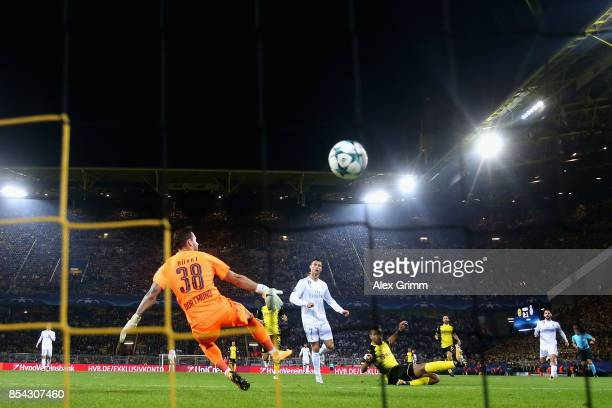 Cristiano Ronaldo of Real Madrid scores his sides second goal past Roman Buerki of Borussia Dortmund during the UEFA Champions League group H match...
