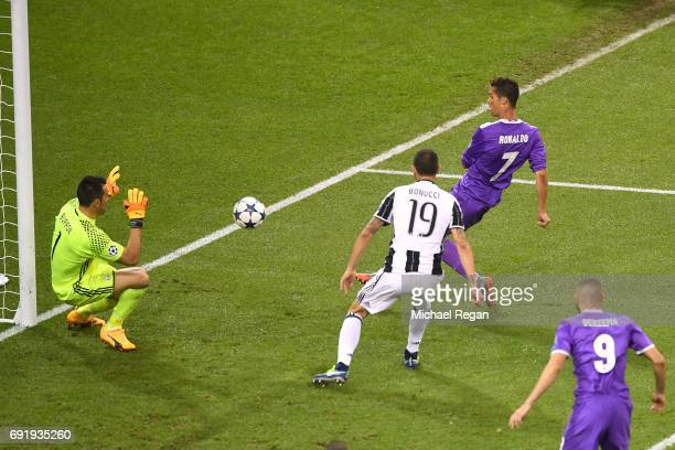 Cristiano Ronaldo of Real Madrid scores his sides third goal during the UEFA Champions League Final between Juventus and Real Madrid at National...