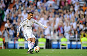 Cristiano Ronaldo of Real Madrid scores his team's 2nd goal from a free kick during the La Liga match between Real Madrid CF and Getafe CF at Estadio...