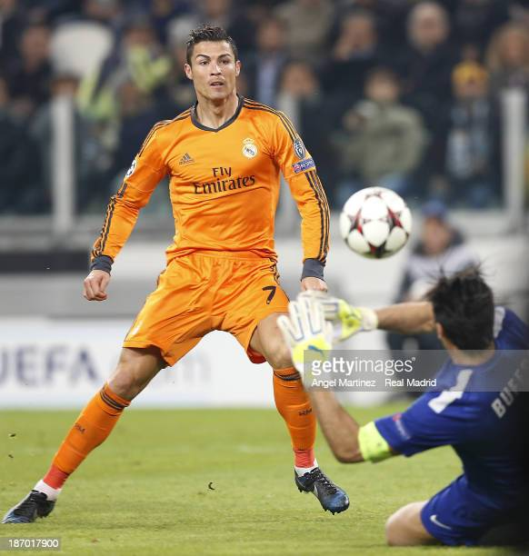 Cristiano Ronaldo of Real Madrid scores his team's first goal past Gianluigi Buffon of Juventus during the UEFA Champions League Group B match...