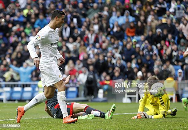 Cristiano Ronaldo of Real Madrid scores his team's fourth goal past Ruben Blanco of Celta Vigo during the La Liga match between Real Madrid CF and...