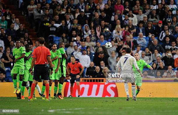 Cristiano Ronaldo of Real Madrid scores his team's opening goal from a free kick during the UEFA Champions League Group F match between Real Madrid...