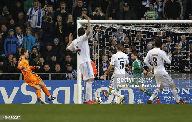Cristiano Ronaldo of Real Madrid scores his team's second goal past goalkeeper Johan Wiland of FC Copenhagen during the UEFA Champions League Group B...