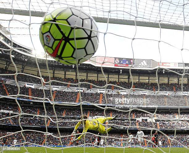 Cristiano Ronaldo of Real Madrid scores his team's second goal past Ruben Blanco of Celta Vigo during the La Liga match between Real Madrid CF and...