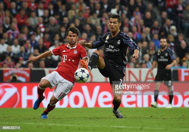 Cristiano Ronaldo of Real Madrid scores his team's second goal past Juan Bernat of FC Bayern Muenchen during the UEFA Champions League Quarter Final...