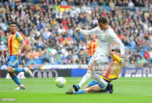 Cristiano Ronaldo of Real Madrid scores his team's third goal during the La Liga match between Real Madrid CF and Valencia CF at Estadio Santiago...
