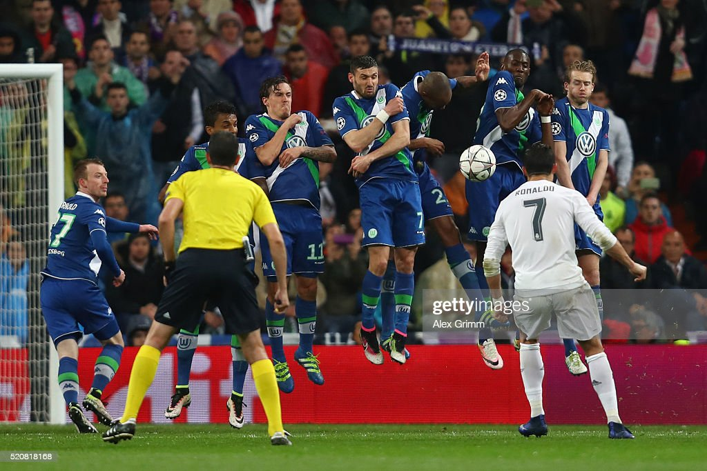 Cristiano Ronaldo of Real Madrid scores his team's third goal with a free-kick during the UEFA Champions league Quarter Final Second Leg match between Real Madrid and VfL Wolfsburg at Estadio Santiago Bernabeu on April 12, 2016 in Madrid, Spain.