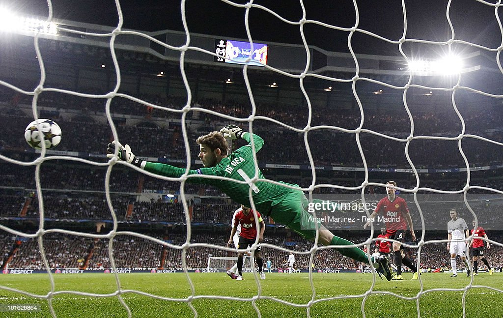 Cristiano Ronaldo of Real Madrid scores past goalkeeper David de Gea of Manchester United during the UEFA Champions League Round of 16 first leg match between Real Madrid and Manchester United at Estadio Santiago Bernabeu on February 13, 2013 in Madrid, Spain.