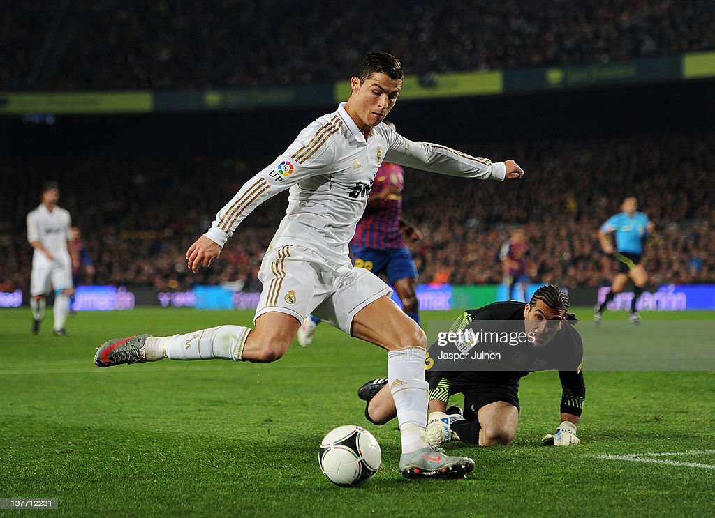 <a gi-track='captionPersonalityLinkClicked' href=/galleries/search?phrase=Cristiano+Ronaldo+-+Soccer+Player&family=editorial&specificpeople=162689 ng-click='$event.stopPropagation()'>Cristiano Ronaldo</a> (L) of Real Madrid scores past Jose Pinto of FC Barcelona during the Copa del Rey quarter final second leg match between Barcelona and Real Madrid at Camp Nou stadium on January 25, 2012 in Barcelona, Spain.