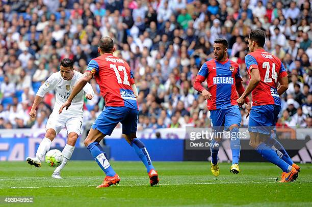 Cristiano Ronaldo of Real Madrid scores Real's 2nd goal during the La Liga match between Real Madrid CF and Levante UD at estadio Santiago Bernabeu...