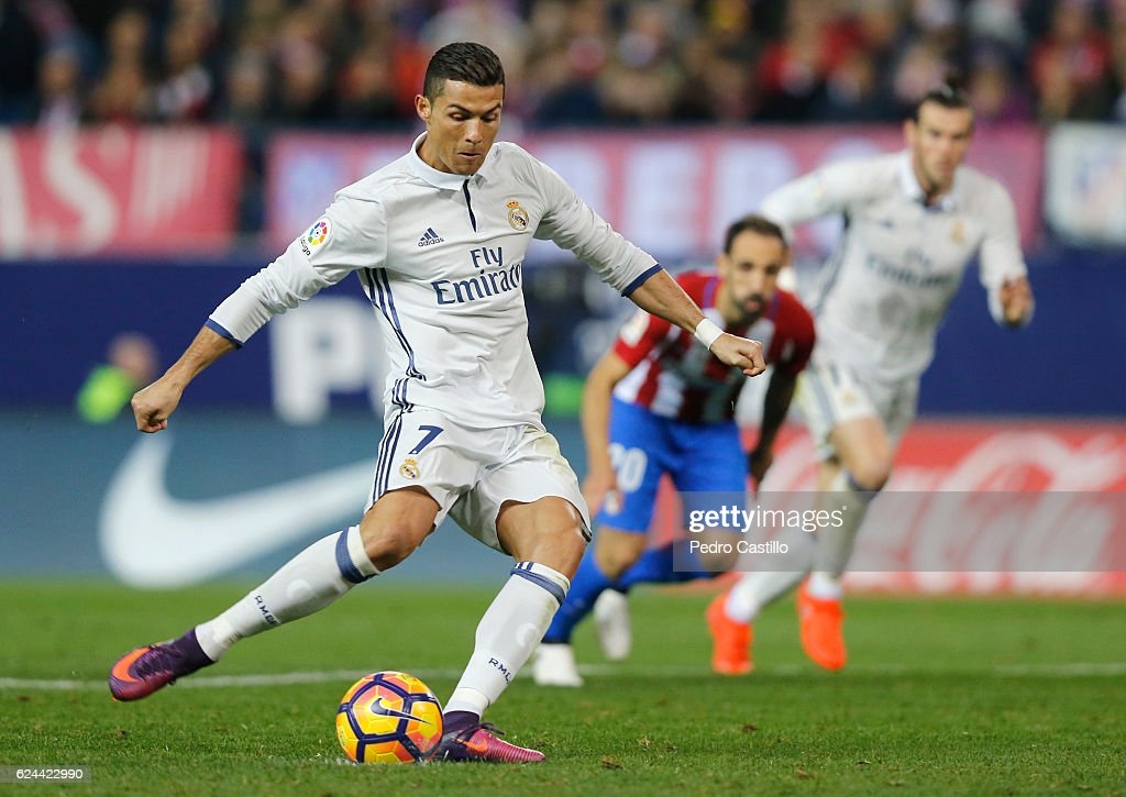 Cristiano Ronaldo of Real Madrid scores Real's 2nd goal during the La Liga match between Club Atletico de Madrid and Real Madrid CF at Vicente Calderon Stadium on November 19, 2016 in Madrid, Spain.