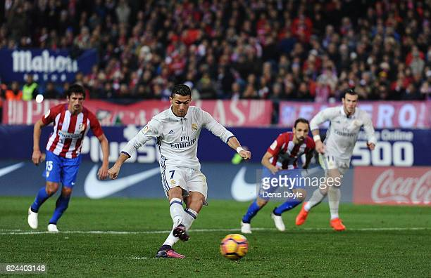Cristiano Ronaldo of Real Madrid scores Real's 2nd goal from the penalty spot during the La Liga match between Club Atletico de Madrid and Real...