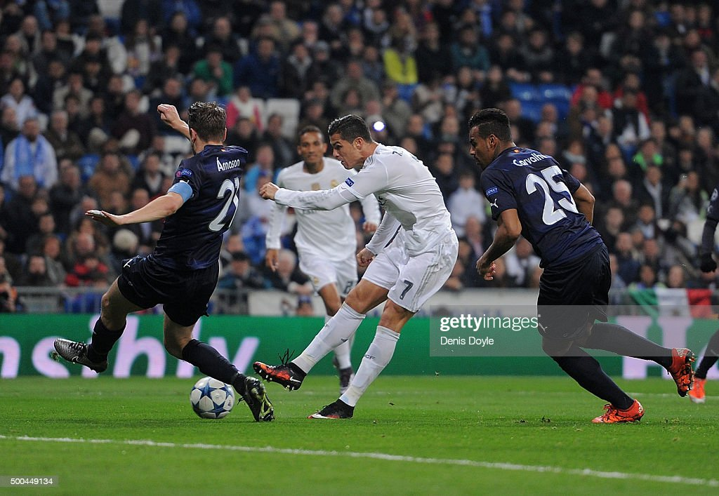Cristiano Ronaldo of Real Madrid scores Real's 5th goal during the UEFA Champions League Group A match between Real Madrid CF and Malmo FF at the Santiago Bernabeu stadium on December 8, 2015 in Madrid, Spain.