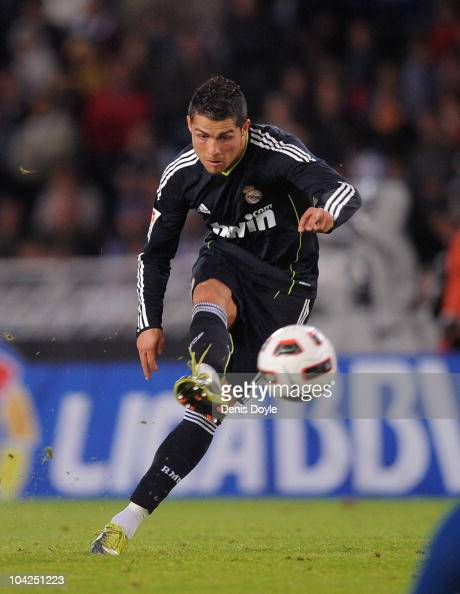 Cristiano Ronaldo of Real Madrid scores Real's second goal from a free kick during the La Liga match between Real Sociedad and Real Madrid at Estadio...