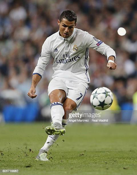 Cristiano Ronaldo of Real Madrid scores scores his sides equalising goal from a free kick during the UEFA Champions League Group F match between Real...