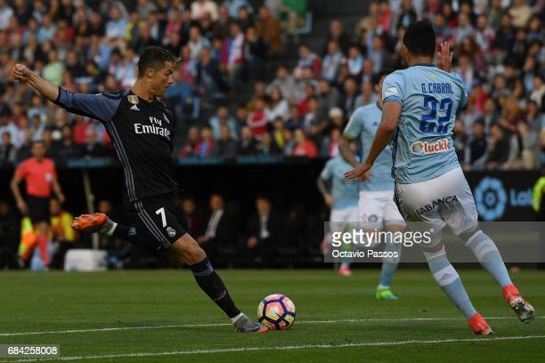 Cristiano Ronaldo of Real Madrid scores the first goal against RC Celta during the La Liga match between Celta Vigo and Real Madrid at Estadio...