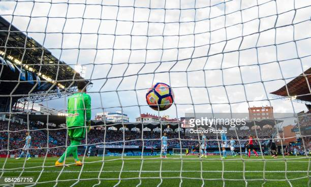 Cristiano Ronaldo of Real Madrid scores the first goal against the head coach Sergio Alvarez of RC Celta during the La Liga match between Celta Vigo...