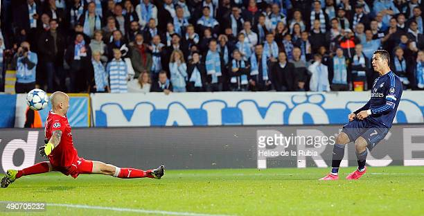 Cristiano Ronaldo of Real Madrid scores the goal during the UEFA Champions League Group A match between Malmo fc and Real Madrid CF at Malmo Stadium...