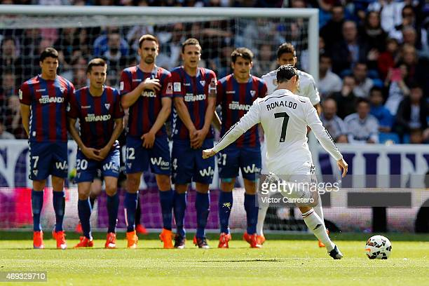 Cristiano Ronaldo of Real Madrid scores the opening goal from a free kick during the La Liga match between Real Madrid CF and Eibar at Estadio...