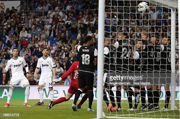 Cristiano Ronaldo of Real Madrid scores the second goal goal from a free kick during the La Liga match between Real Madrid and Malaga at Estadio...