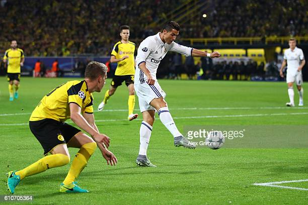 Cristiano Ronaldo of Real Madrid scores their first goal during the UEFA Champions League Group F match between Borussia Dortmund and Real Madrid CF...