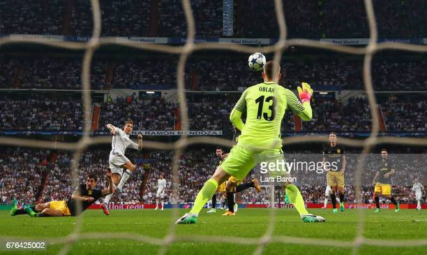 Cristiano Ronaldo of Real Madrid scores their second goal past goalkeeper Jan Oblak of Atletico Madrid during the UEFA Champions League semi final...