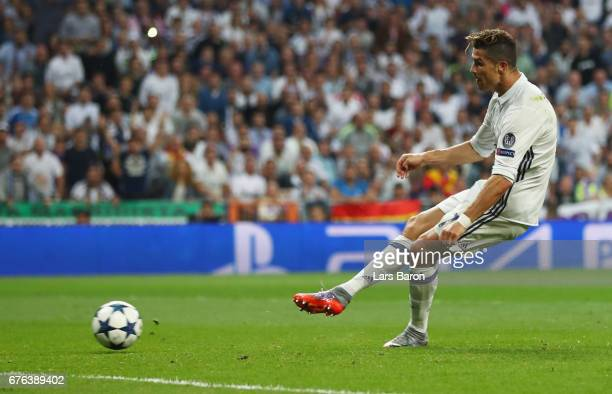 Cristiano Ronaldo of Real Madrid scores their third goal and completes his hat trick during the UEFA Champions League semi final first leg match...