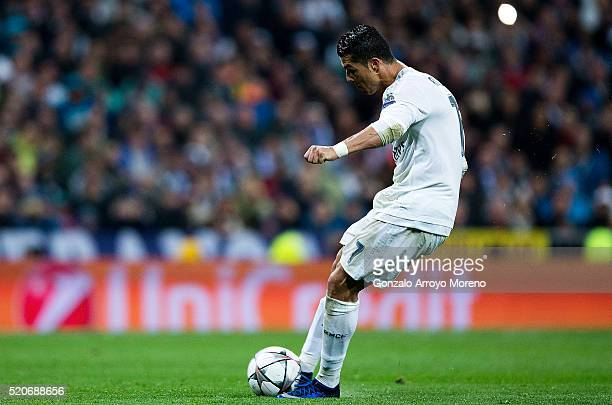 Cristiano Ronaldo of Real Madrid scores their third goal from a free kick and completes his hat trick during the UEFA Champions League quarter final...