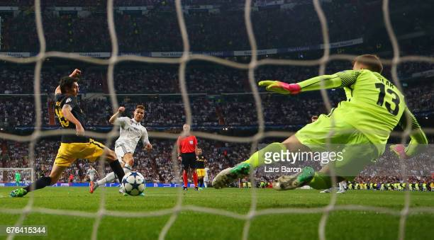 Cristiano Ronaldo of Real Madrid scores their third goal past goalkeeper Jan Oblak of Atletico Madrid during the UEFA Champions League semi final...