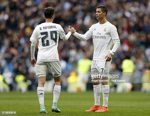 Cristiano Ronaldo of Real Madrid shakes hands with Borja Mayoral during the La Liga match between Real Madrid CF and Celta Vigo at Estadio Santiago...