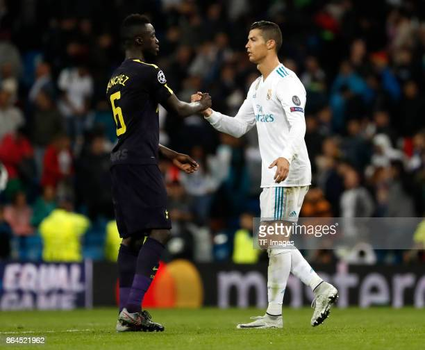 Cristiano Ronaldo of Real Madrid shakes hands with Davinson Sanchez of Tottenham during the UEFA Champions League group H match between Real Madrid...