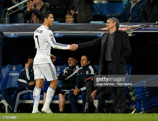 Cristiano Ronaldo of Real Madrid shakes hands with head coach Jose Mourinho during the UEFA Champions League round of 16 second leg match between...