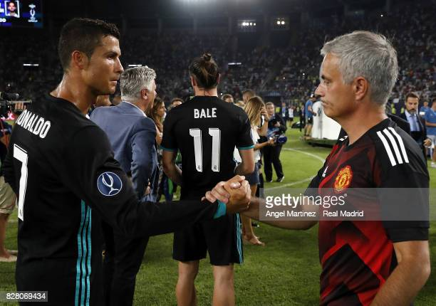 Cristiano Ronaldo of Real Madrid shakes hands with head coach Jose Mourinho of Manchester United after the UEFA Super Cup match between Real Madrid...
