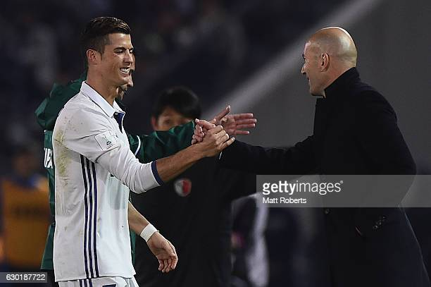Cristiano Ronaldo of Real Madrid shakes hands with Real Madrid coach Zinedine Zidane during the FIFA Club World Cup final match between Real Madrid...