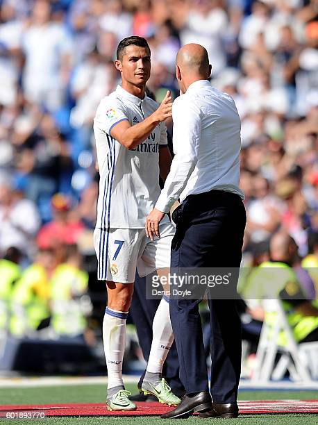 Cristiano Ronaldo of Real Madrid shakes hands with Real Manager Zinedine Zidane after being substituted during the La Liga match between Real Madrid...