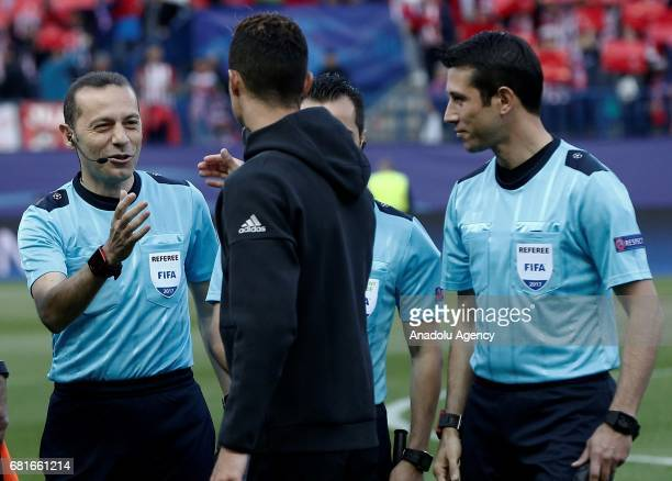 Cristiano Ronaldo of Real Madrid shakes hands with referee of the match Cuneyt Cakir ahead the UEFA Champions League semi final second leg match...