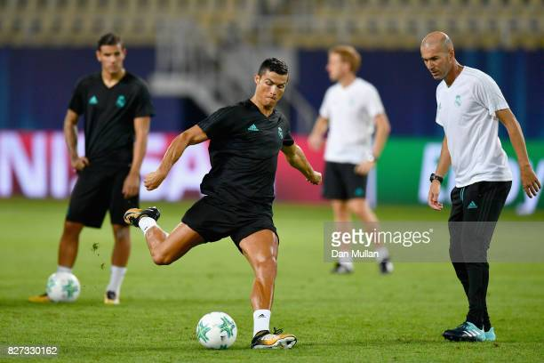 Cristiano Ronaldo of Real Madrid shoots as Zinedine Zidane Manager of Real Madrid watches during a training session ahead of the UEFA Super Cup final...